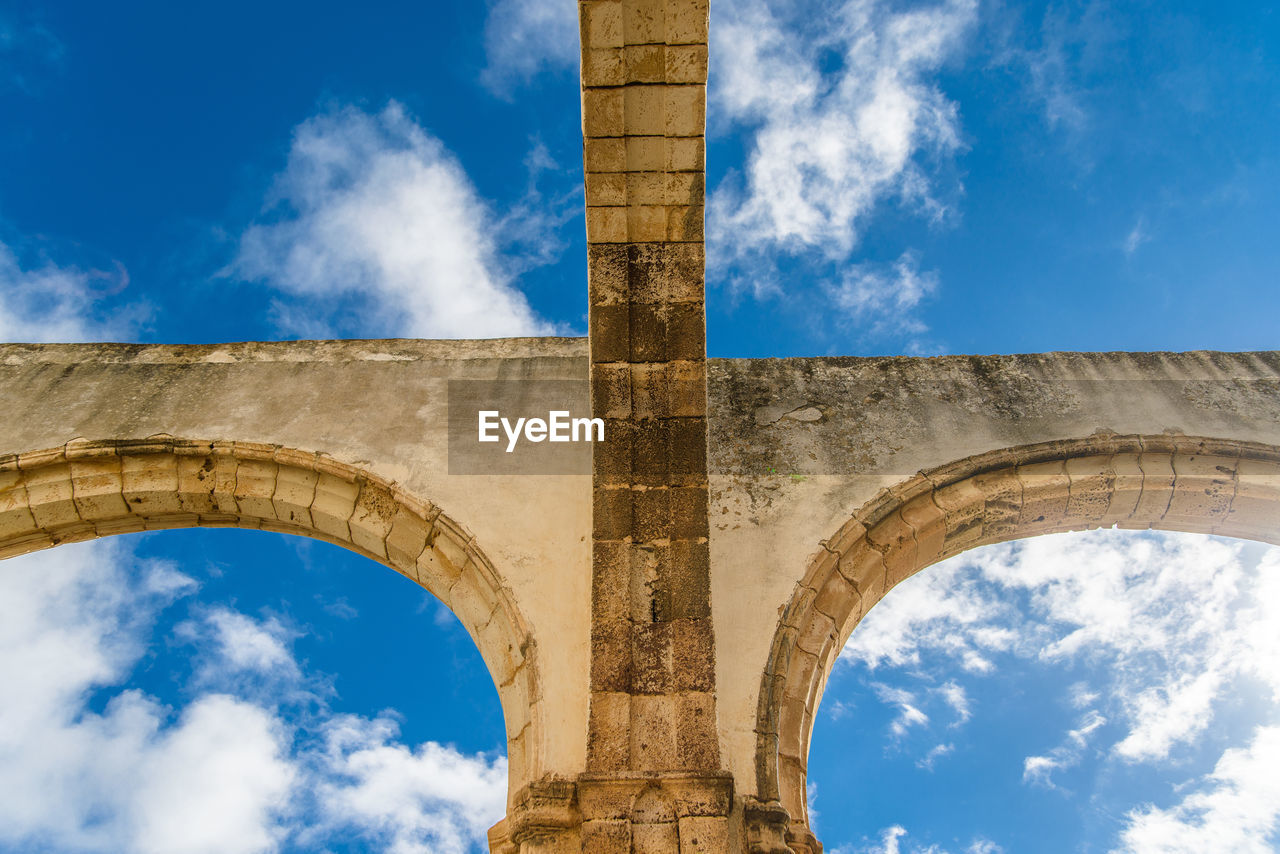 architecture, built structure, cloud - sky, sky, low angle view, arch, nature, history, architectural column, the past, day, no people, blue, bridge, connection, bridge - man made structure, outdoors, old, building exterior, ancient, ruined, arch bridge