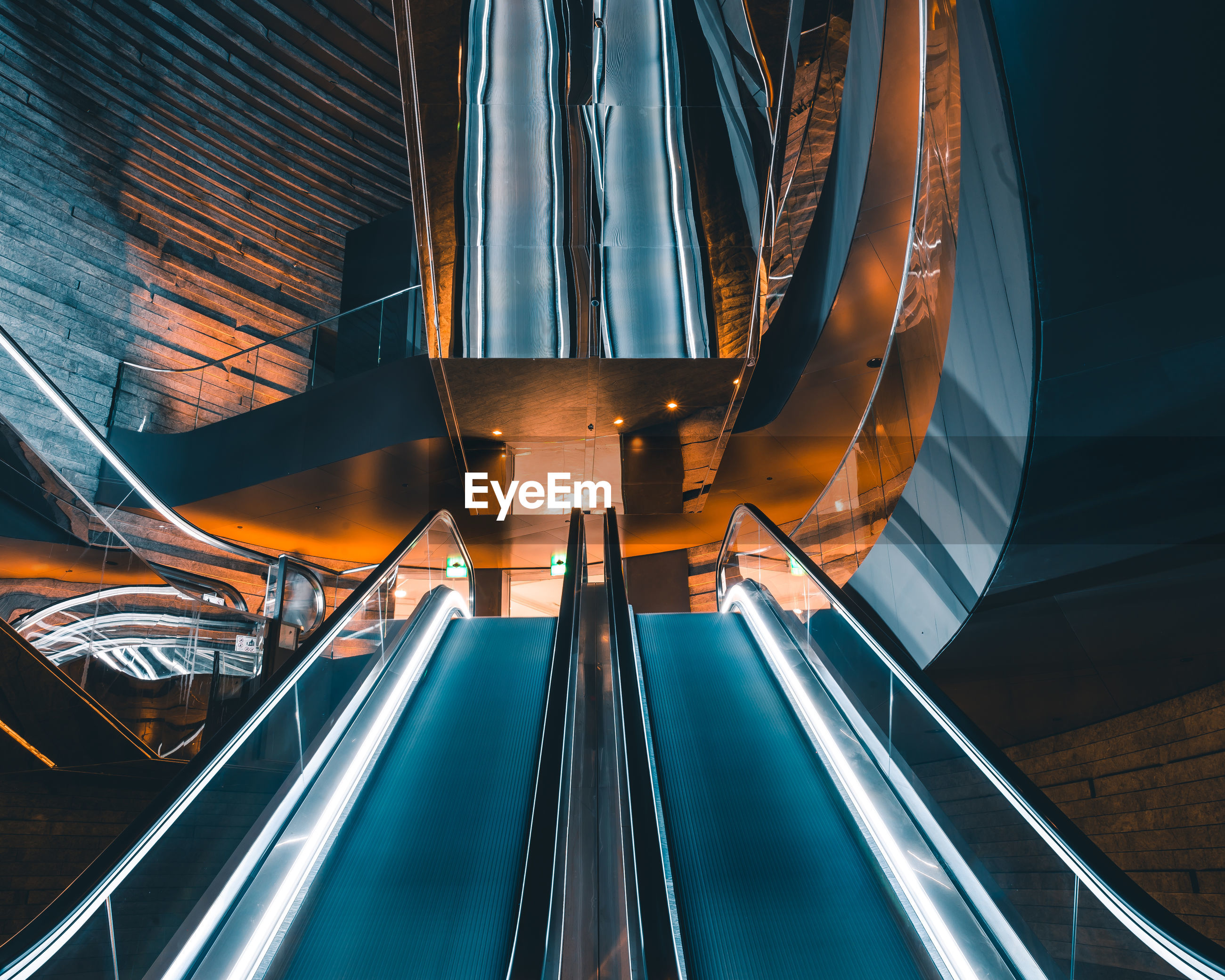 Low angle view of escalator in shopping mall