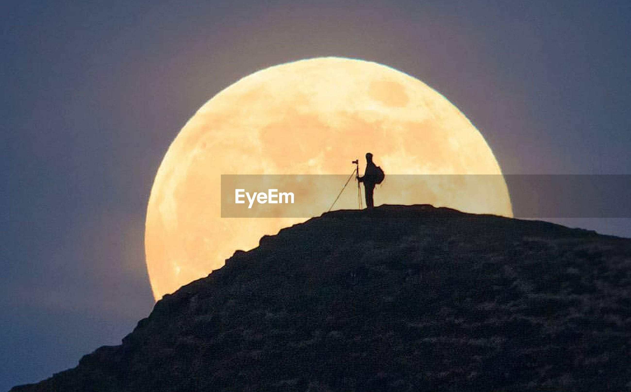 silhouette, moon, nature, mountain, sunset, adventure, sky, one man only, standing, outdoors, only men, full length, mountain peak, one person, tranquility, cloud - sky, people, hiking, low angle view, adult, beauty in nature, landscape, cliff, night, adults only, rock climbing, scenics, star - space, astronomy