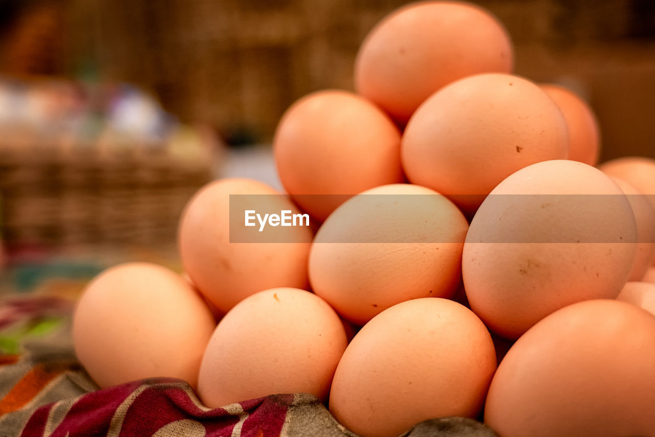 food, food and drink, healthy eating, wellbeing, large group of objects, egg, freshness, still life, close-up, no people, market, for sale, raw food, abundance, focus on foreground, arrangement, brown, market stall, retail, indoors