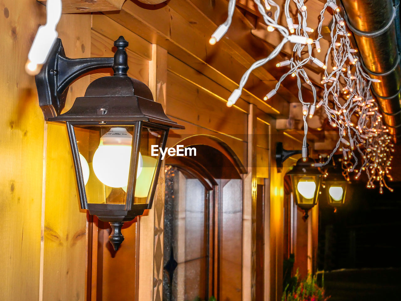 lighting equipment, illuminated, architecture, no people, hanging, light, focus on foreground, low angle view, indoors, built structure, electric lamp, electricity, electric light, glowing, wood - material, decoration, building, light - natural phenomenon, lantern, glass - material, ceiling