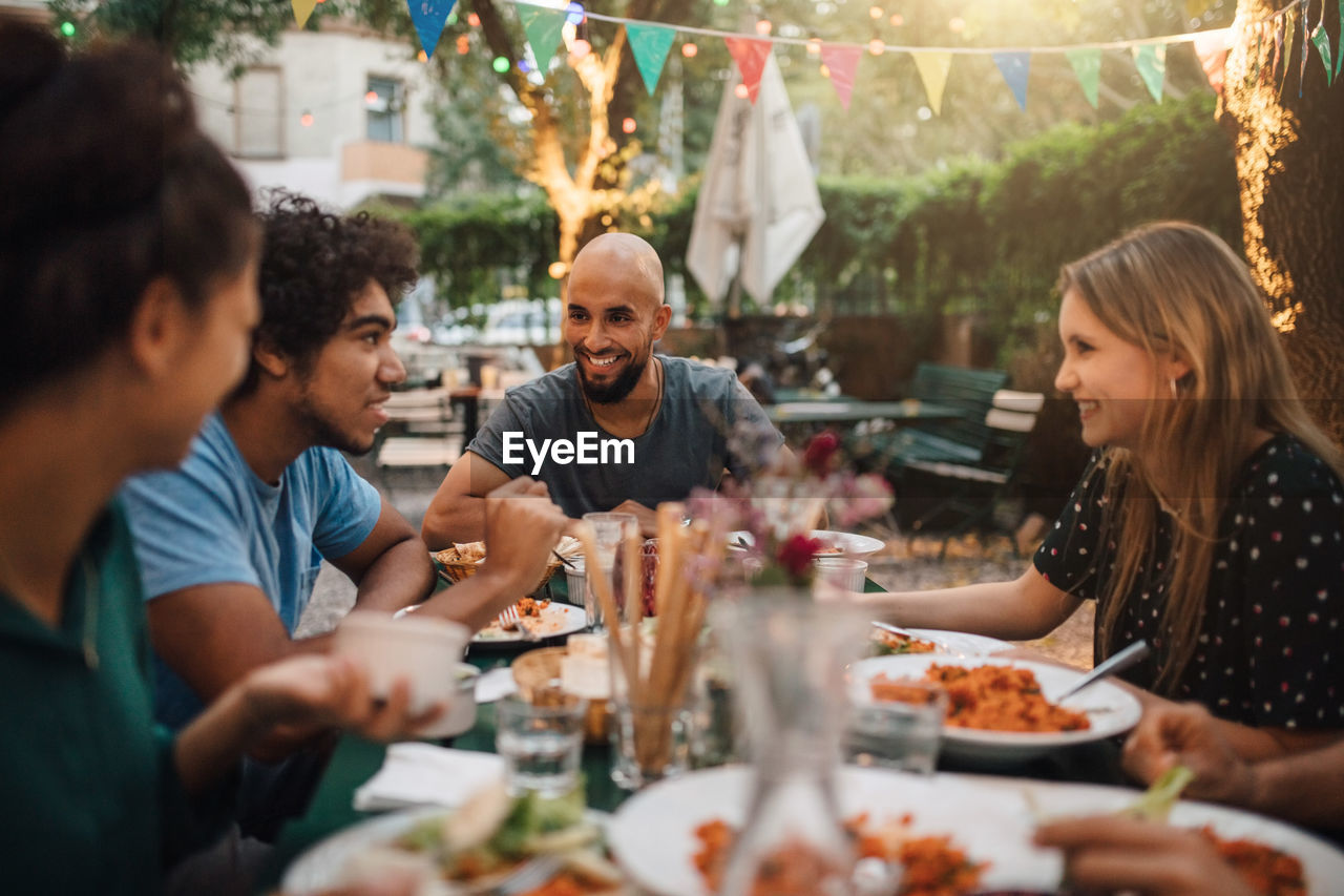 group of people, togetherness, food and drink, table, enjoyment, women, smiling, bonding, men, sitting, mid adult, friendship, celebration, males, real people, selective focus, adult, mid adult men, food, happiness, meal