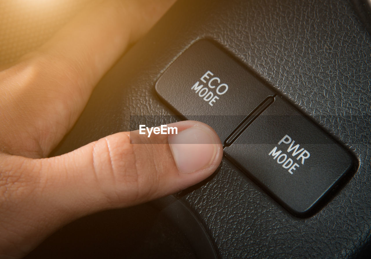 human hand, hand, human body part, technology, finger, human finger, body part, communication, real people, close-up, indoors, control, western script, one person, black color, text, personal perspective, travel, mode of transportation, push button, personal accessory