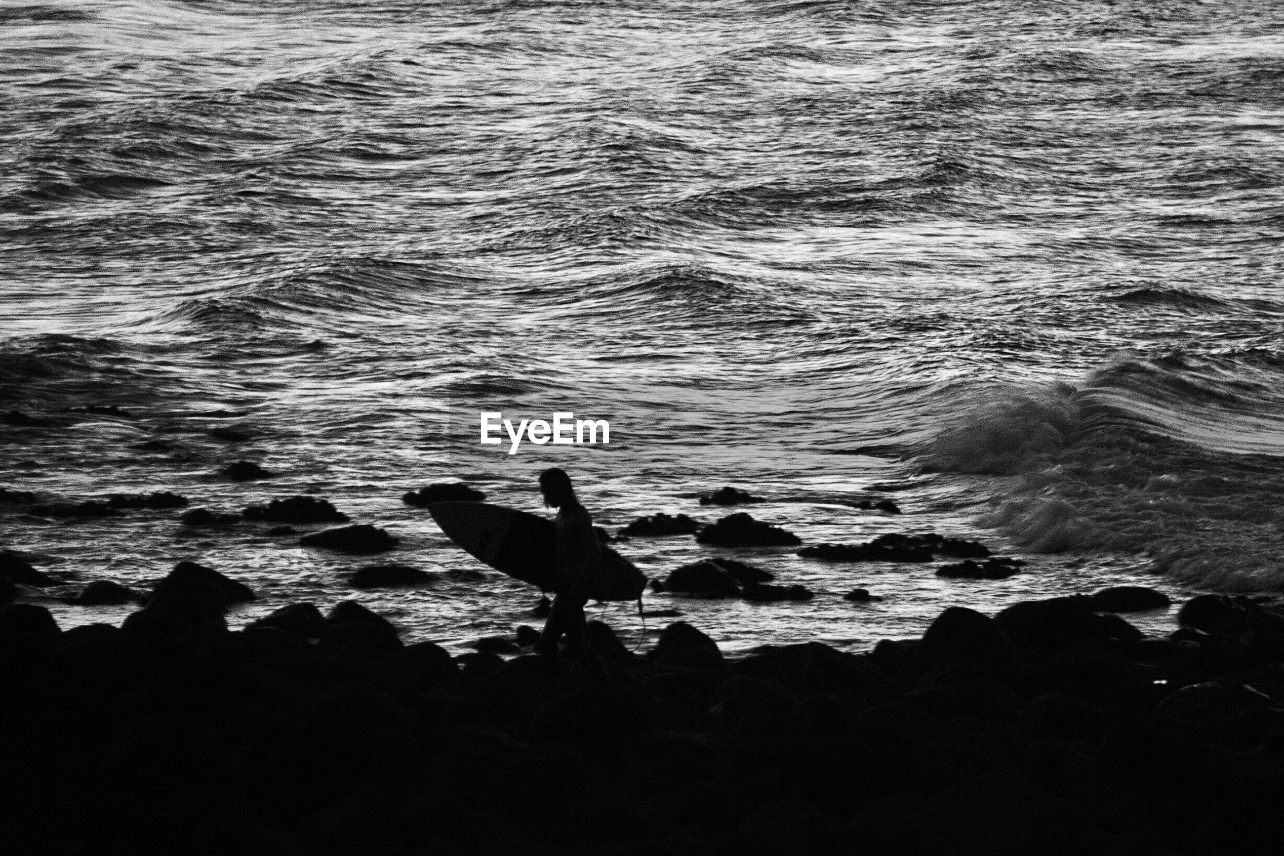 Scenic view of silhouette shore and sea