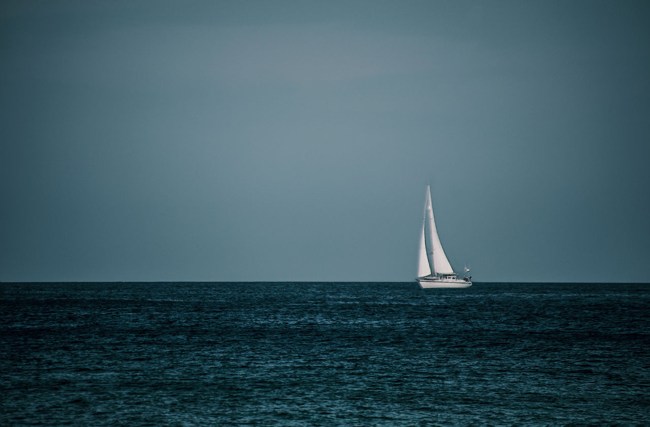 sea, horizon over water, water, waterfront, sailboat, sailing, scenics, transportation, tranquil scene, tranquility, outdoors, beauty in nature, sky, nature, clear sky, nautical vessel, mode of transport, no people, mast, day, scenery