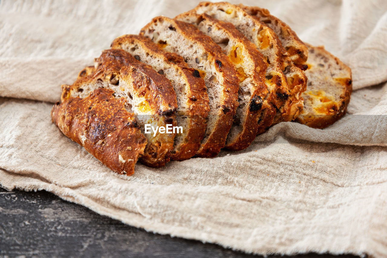 food and drink, food, close-up, freshness, no people, indoors, bread, still life, textile, wellbeing, ready-to-eat, healthy eating, studio shot, brown, high angle view, paper, selective focus, napkin, slice, meal, dinner, brown bread