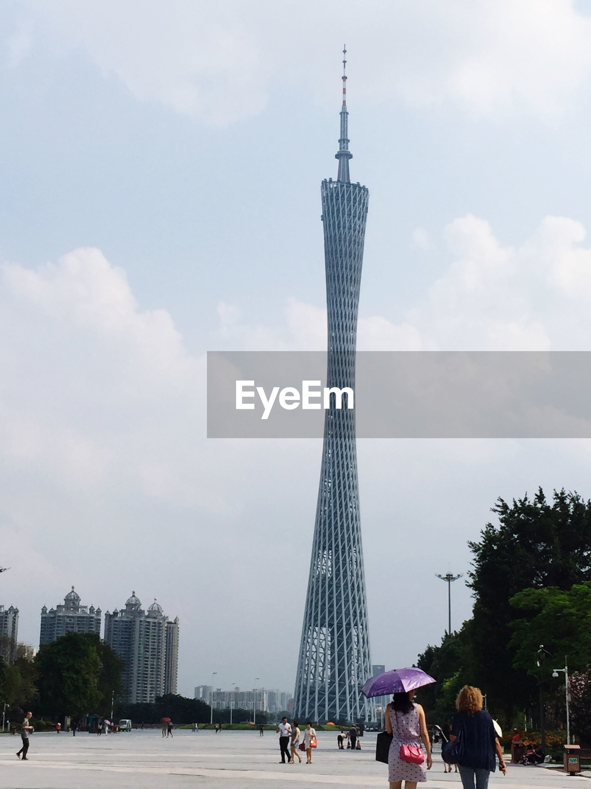Low angle view of canton tower in city