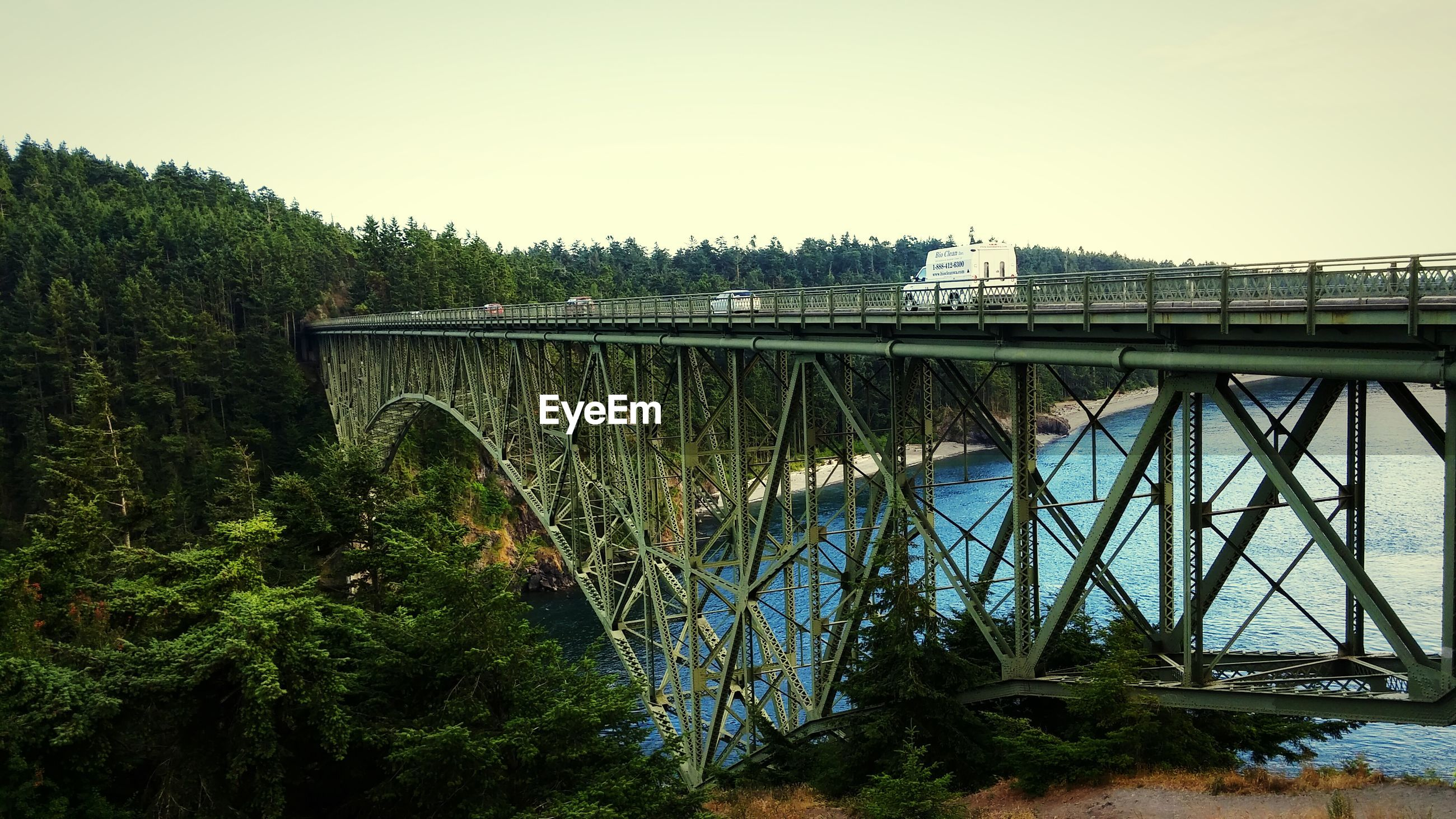 High angle view of deception pass bridge over river against clear sky