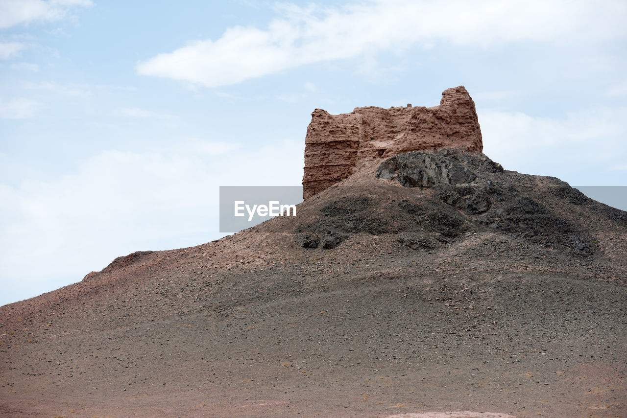 sky, cloud - sky, rock, solid, rock - object, history, rock formation, nature, mountain, the past, land, day, low angle view, architecture, beauty in nature, physical geography, no people, scenics - nature, travel destinations, tranquil scene, outdoors, ancient civilization, arid climate, climate