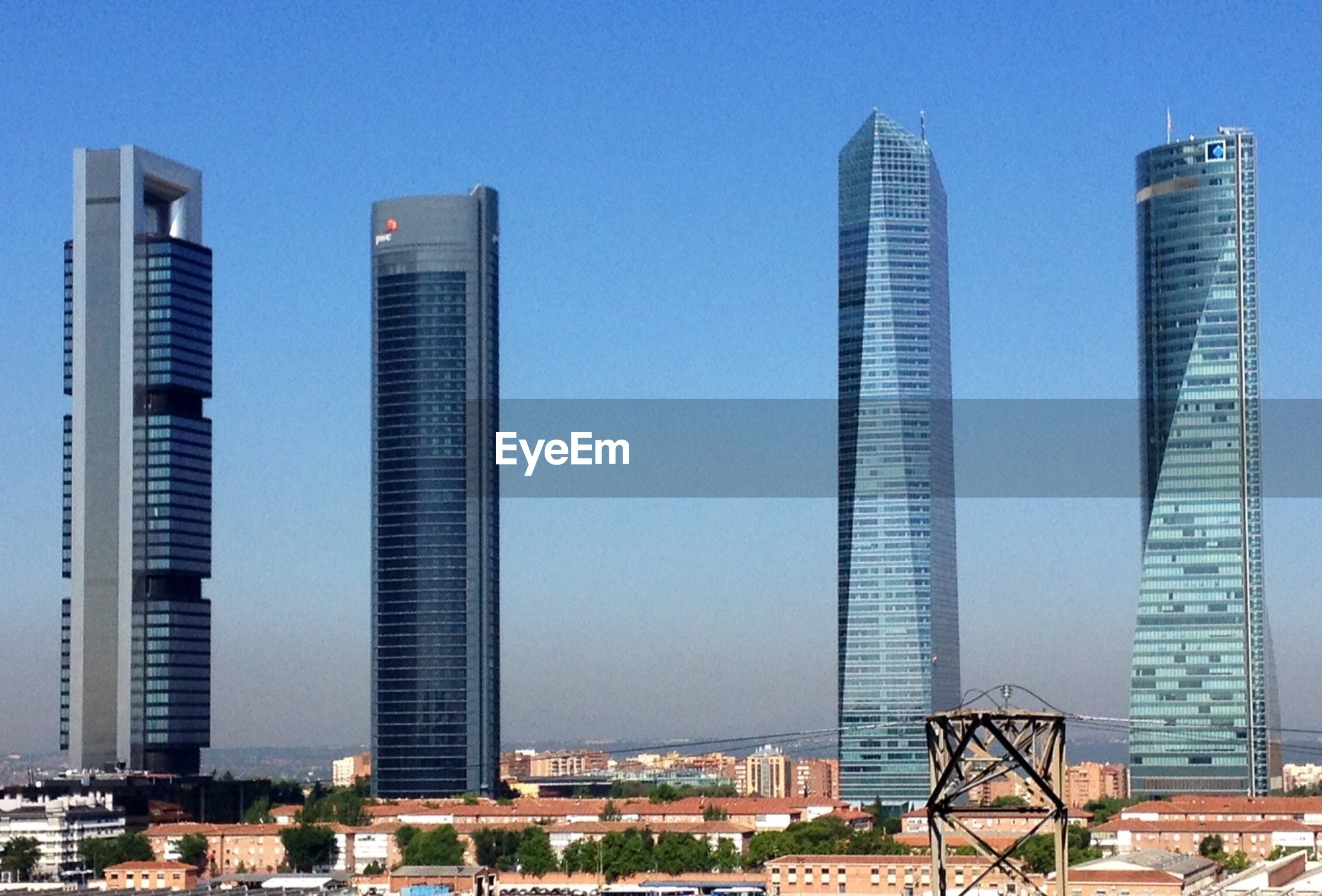 building exterior, architecture, city, skyscraper, built structure, modern, tall - high, office building, cityscape, tower, clear sky, urban skyline, financial district, building, blue, development, tall, low angle view, city life, sky
