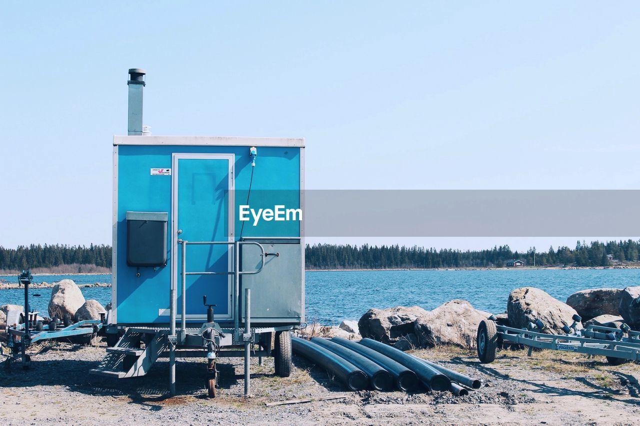 Portable Toilet On Shore Against Sky