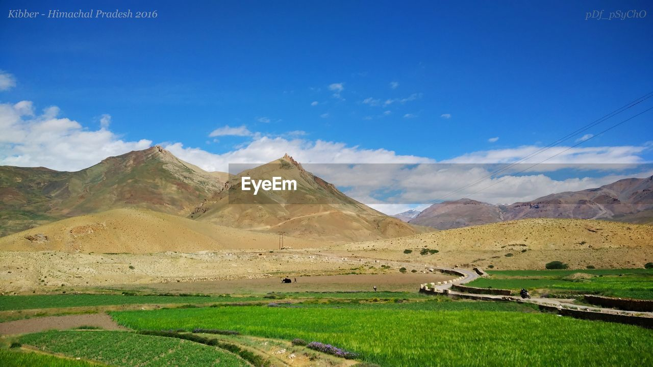 mountain, scenics, mountain range, landscape, beauty in nature, nature, tranquil scene, tranquility, sky, cloud - sky, day, outdoors, no people, physical geography, salt flat, grass, salt - mineral