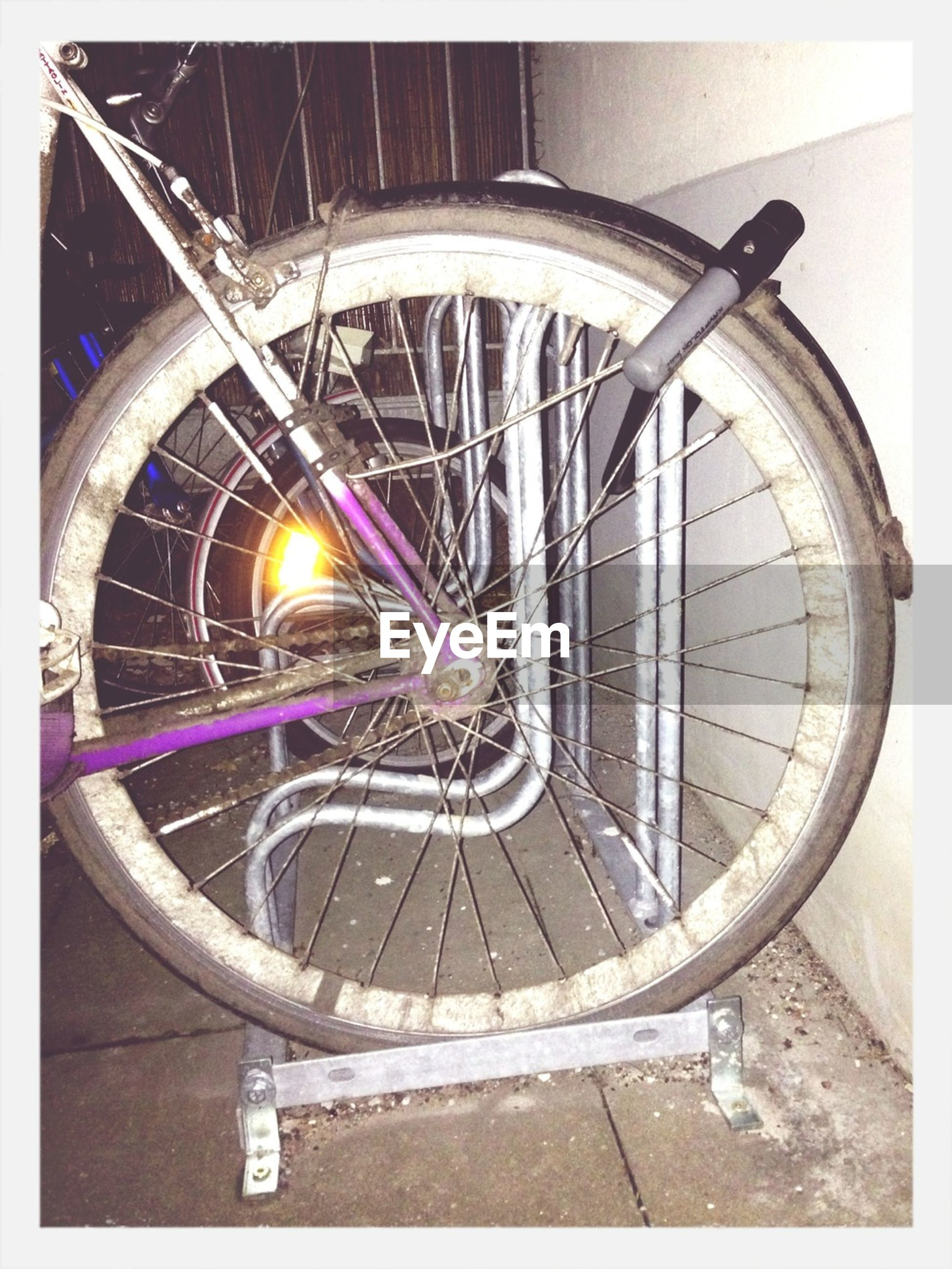 transfer print, circle, built structure, wheel, illuminated, auto post production filter, architecture, transportation, railing, metal, no people, close-up, indoors, night, bicycle, spiral, land vehicle, mode of transport, round