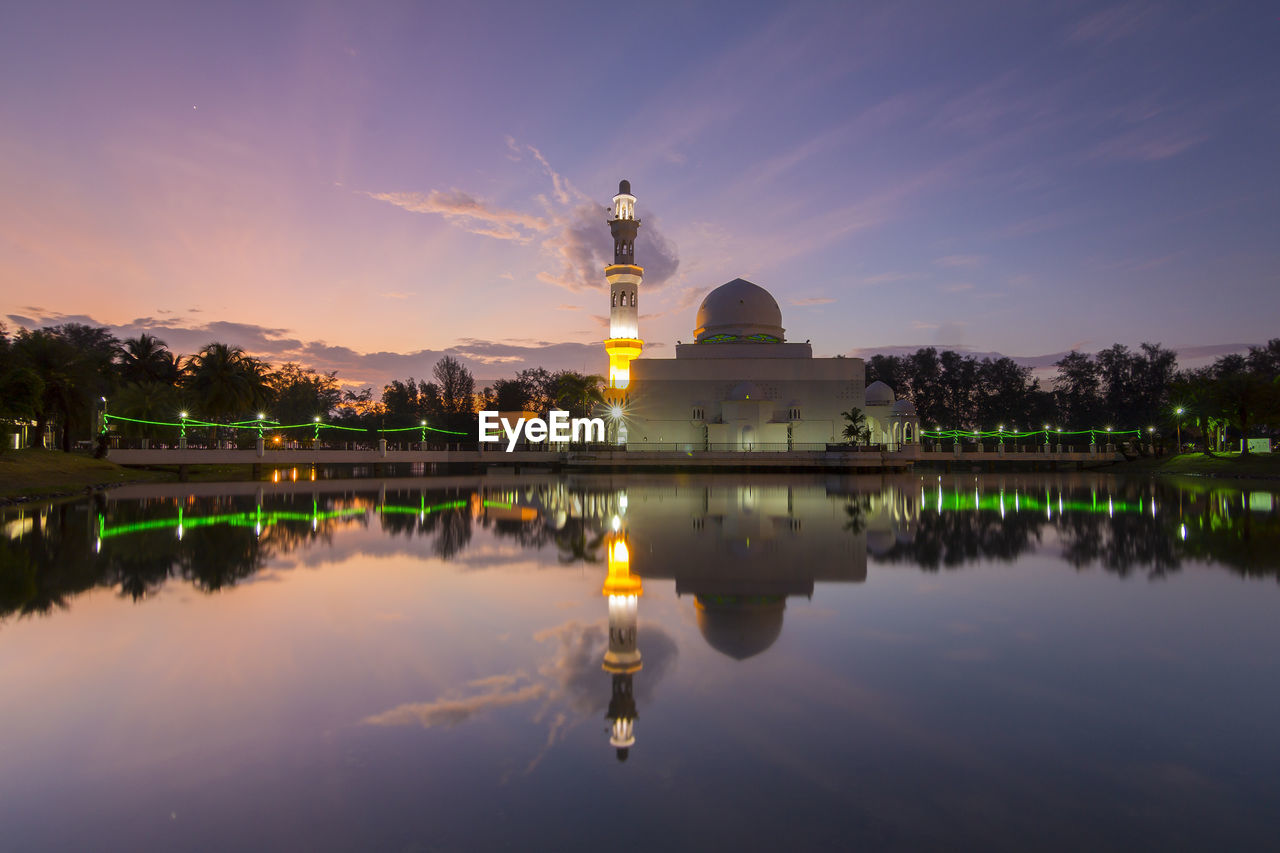 sky, architecture, water, reflection, built structure, building exterior, nature, sunset, lake, waterfront, illuminated, place of worship, religion, spirituality, belief, history, building, travel, government