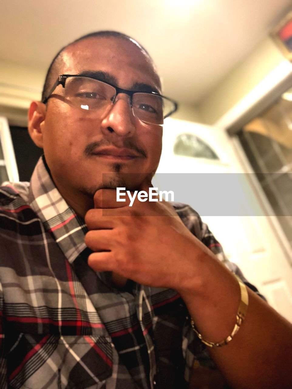 portrait, glasses, eyeglasses, real people, headshot, one person, men, indoors, males, young adult, front view, lifestyles, low angle view, casual clothing, young men, leisure activity, looking at camera, mid adult men, mid adult, mature men, human face, contemplation