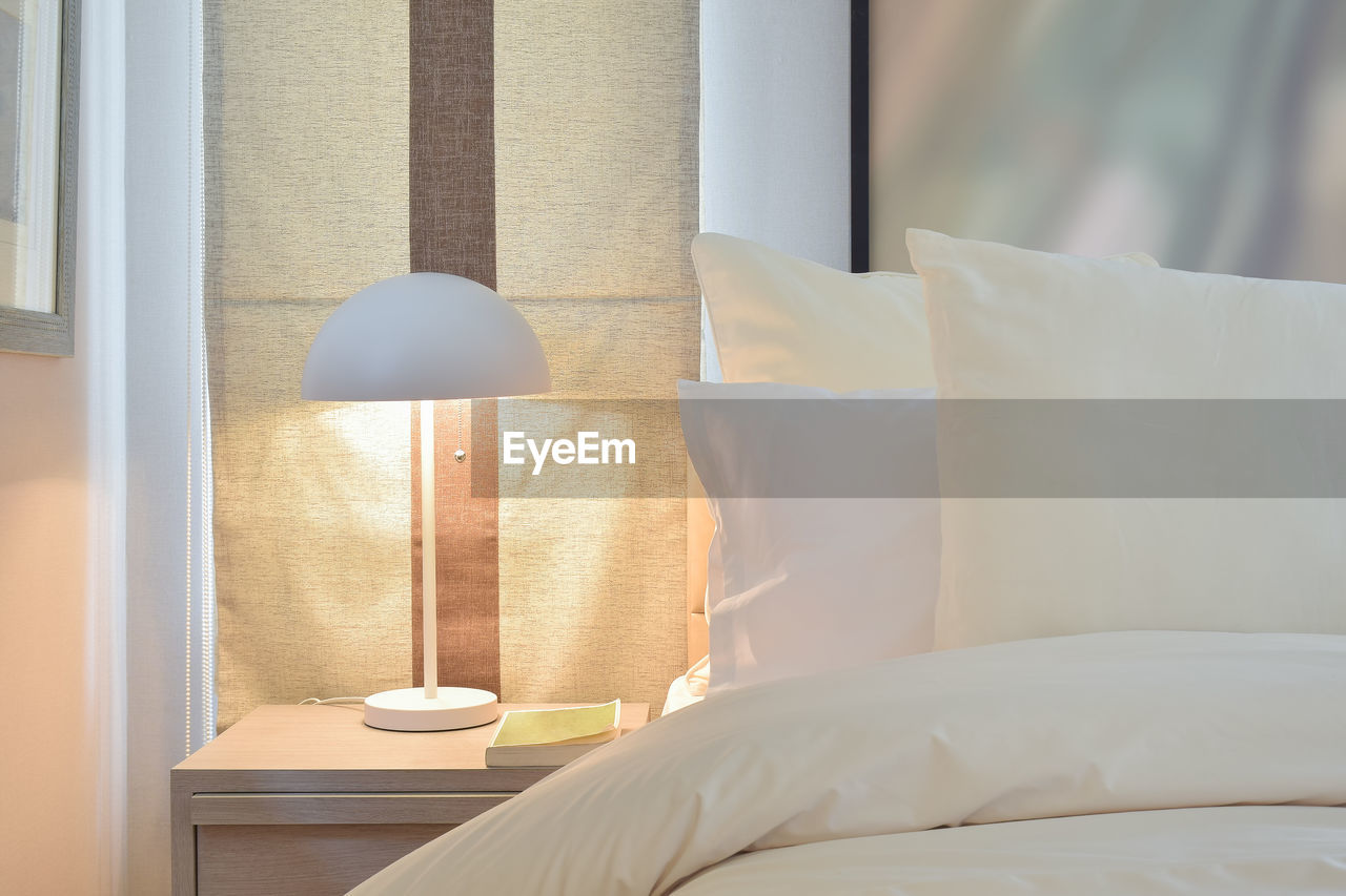 furniture, bed, bedroom, pillow, indoors, no people, lighting equipment, home interior, home showcase interior, domestic room, electric lamp, white color, absence, comfortable, lamp shade, modern, hotel, stuffed, cup, textile, hotel room, cozy, luxury, light