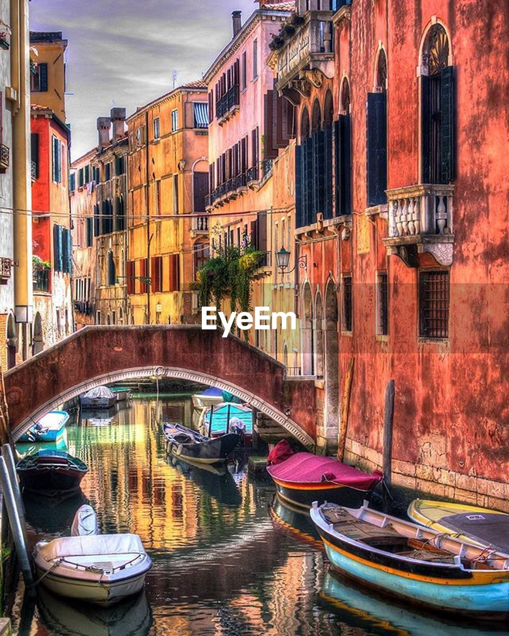 nautical vessel, water, building exterior, architecture, canal, transportation, built structure, mode of transportation, city, waterfront, moored, reflection, nature, travel destinations, travel, connection, bridge, day, no people, gondola - traditional boat, outdoors, passenger craft, wooden post, rowboat, arch bridge