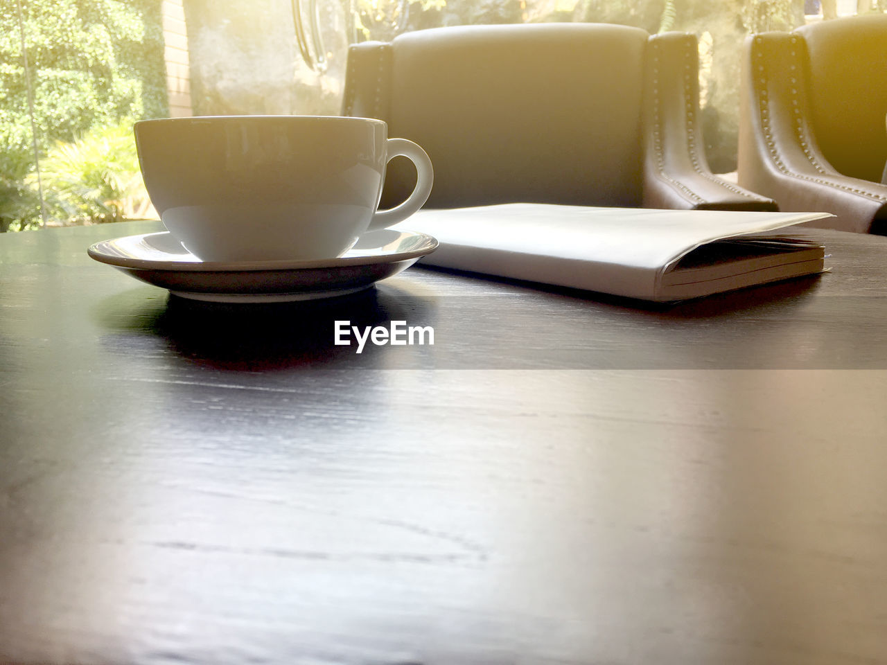 cup, table, mug, food and drink, coffee cup, still life, indoors, drink, saucer, crockery, no people, coffee, refreshment, coffee - drink, tea cup, close-up, kitchen utensil, ceramics, day, eating utensil, surface level