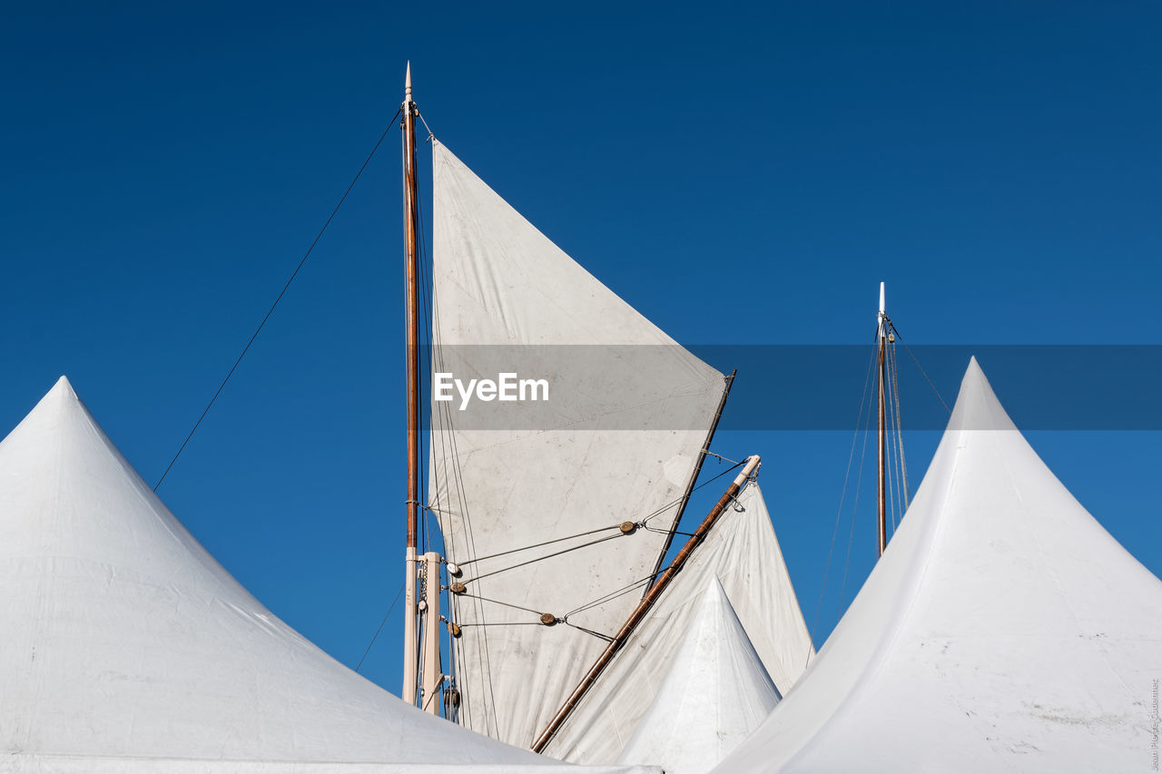 Low Angle View Of Sailing Ship Masts Against Clear Blue Sky