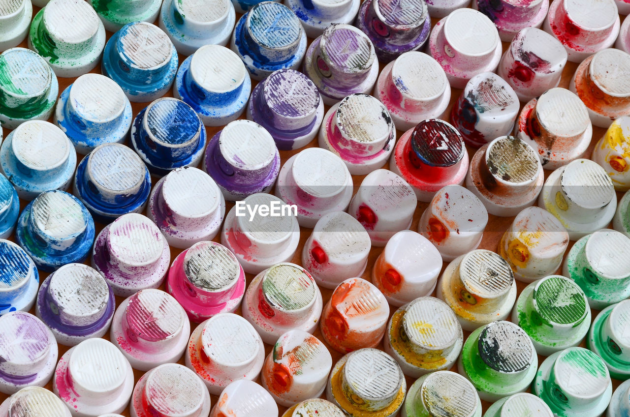 large group of objects, full frame, multi colored, abundance, choice, backgrounds, variation, still life, high angle view, no people, indoors, collection, close-up, for sale, business, directly above, retail, shape, art and craft, stack