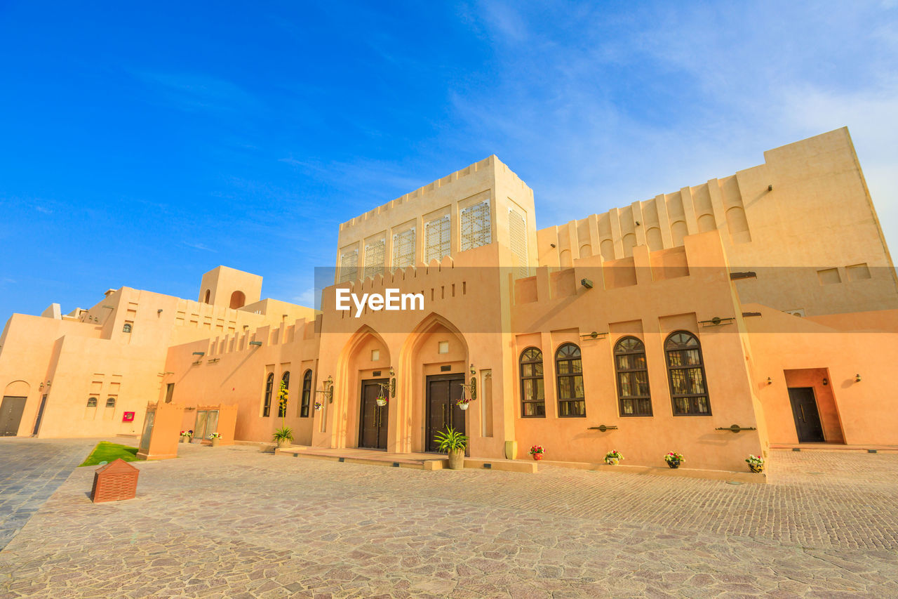 architecture, built structure, sky, history, arch, building exterior, the past, blue, building, nature, no people, day, travel destinations, low angle view, outdoors, travel, entrance, cloud - sky, city, facade, architectural column, courtyard, ancient civilization