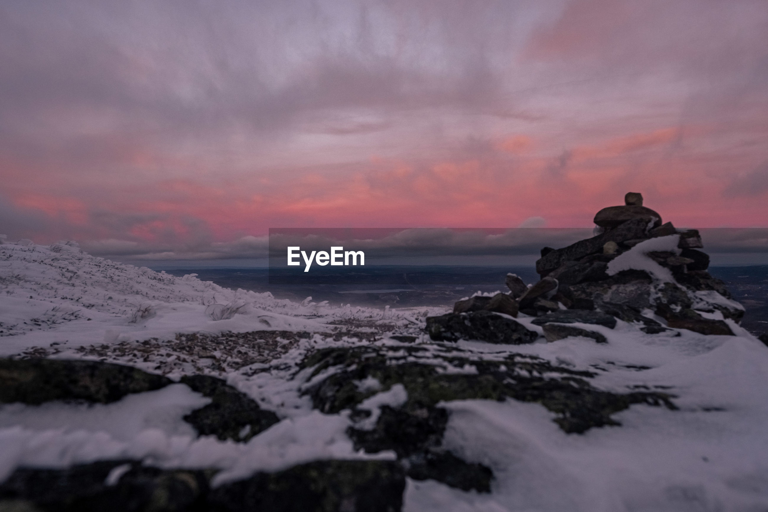 Scenic view of winter mountains against sky during sunset