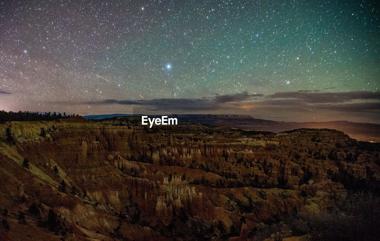 Scenic View Of Rocky Mountains Against Star Field At Night