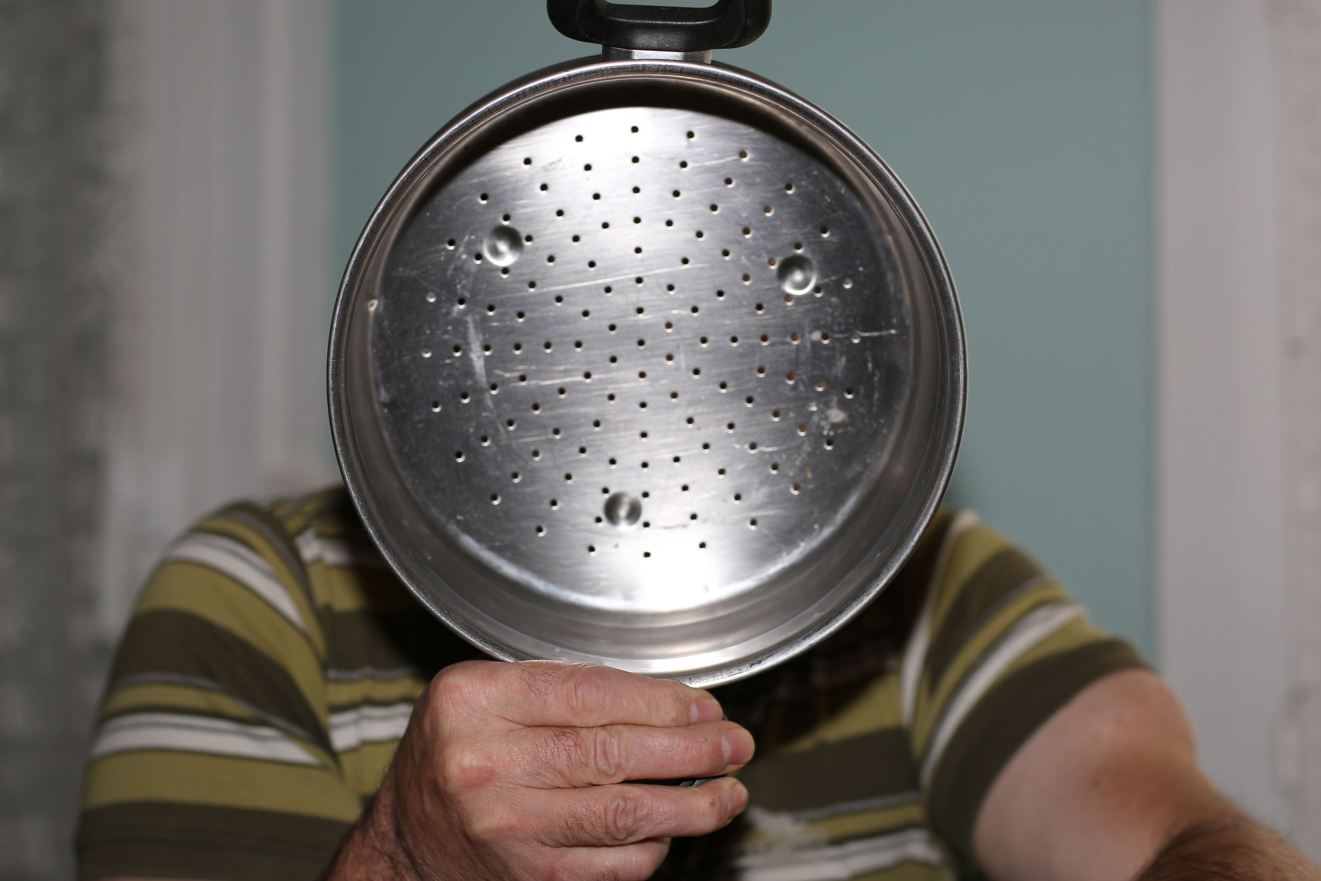 Close-up of person holding colander