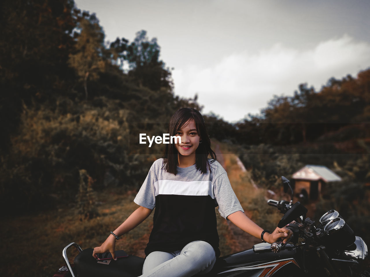 Portrait of smiling woman sitting on her motocycle