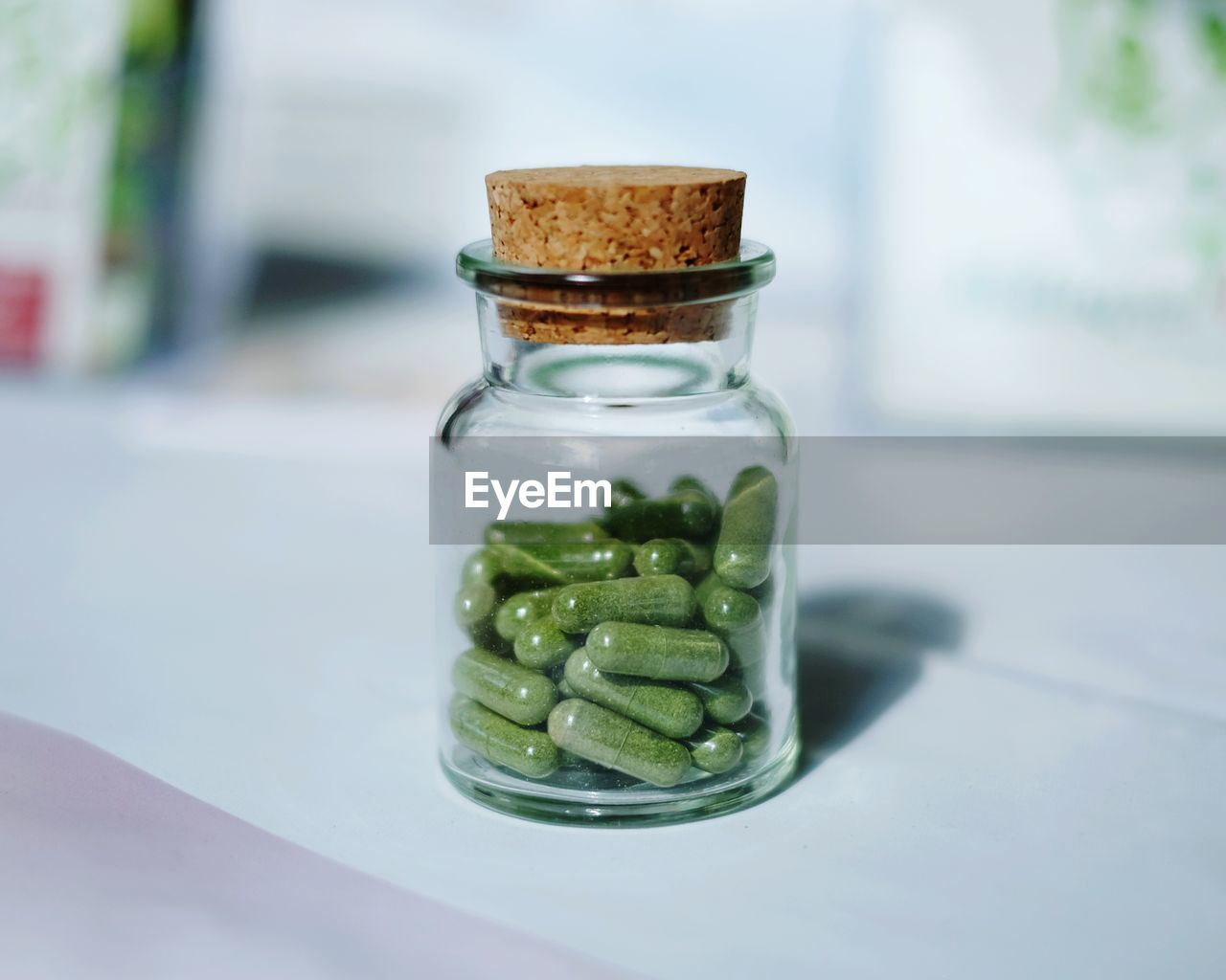 Close-up of capsules in glass bottle