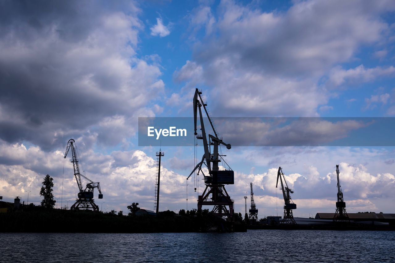 cloud - sky, sky, water, crane - construction machinery, machinery, industry, sea, no people, commercial dock, waterfront, nature, silhouette, pier, shipping, harbor, nautical vessel, outdoors, business, construction industry, construction equipment