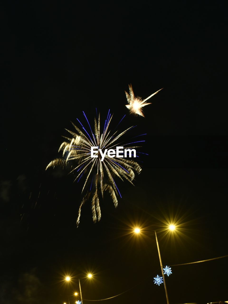 illuminated, night, glowing, firework display, lighting equipment, low angle view, firework - man made object, long exposure, celebration, blurred motion, arts culture and entertainment, motion, no people, firework, outdoors, sparkler, sky