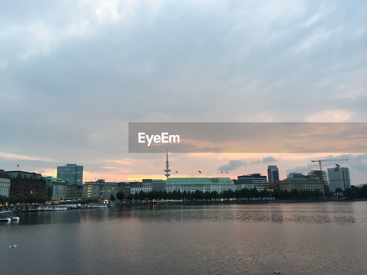 architecture, building exterior, built structure, city, water, sky, cityscape, waterfront, skyscraper, cloud - sky, river, no people, modern, urban skyline, travel destinations, outdoors, sunset, nature, day