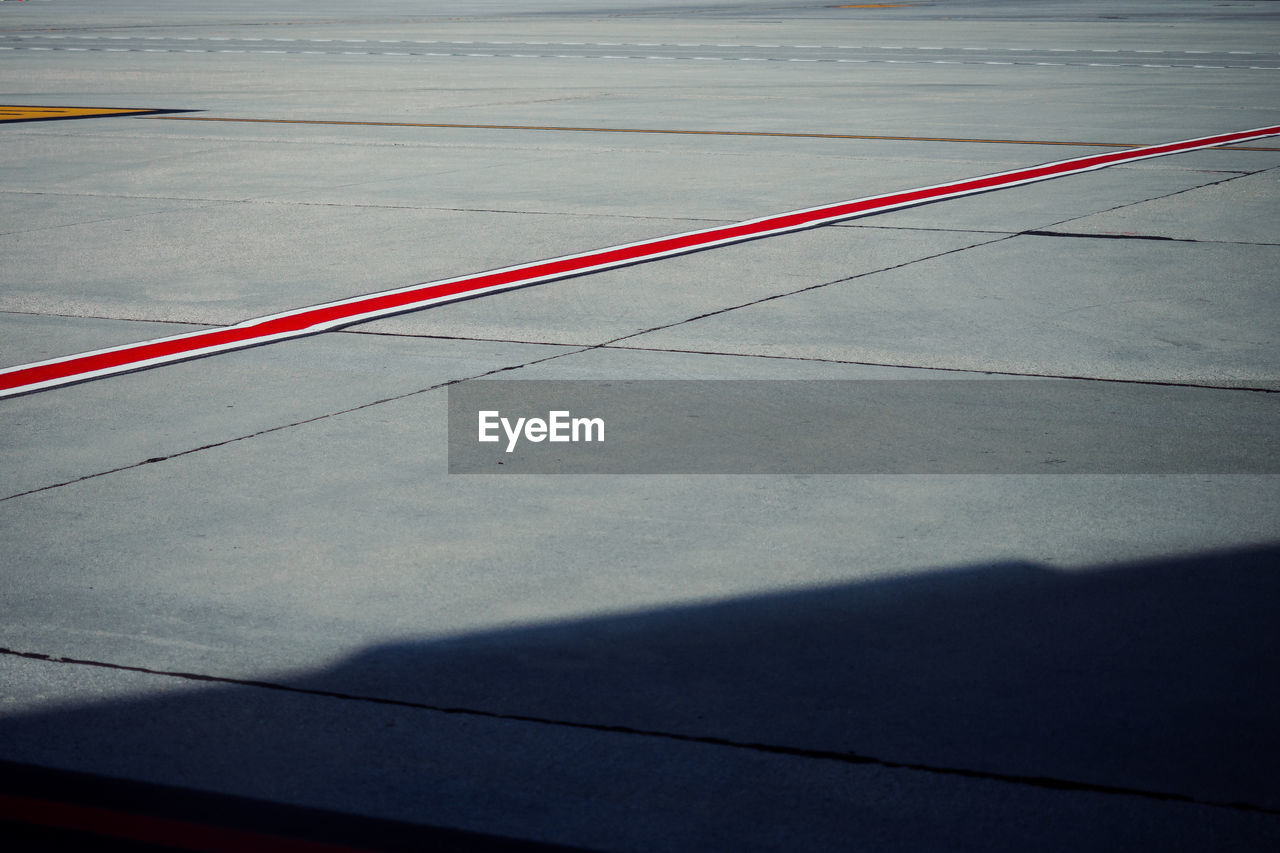 High Angle View Of Red Line On Road