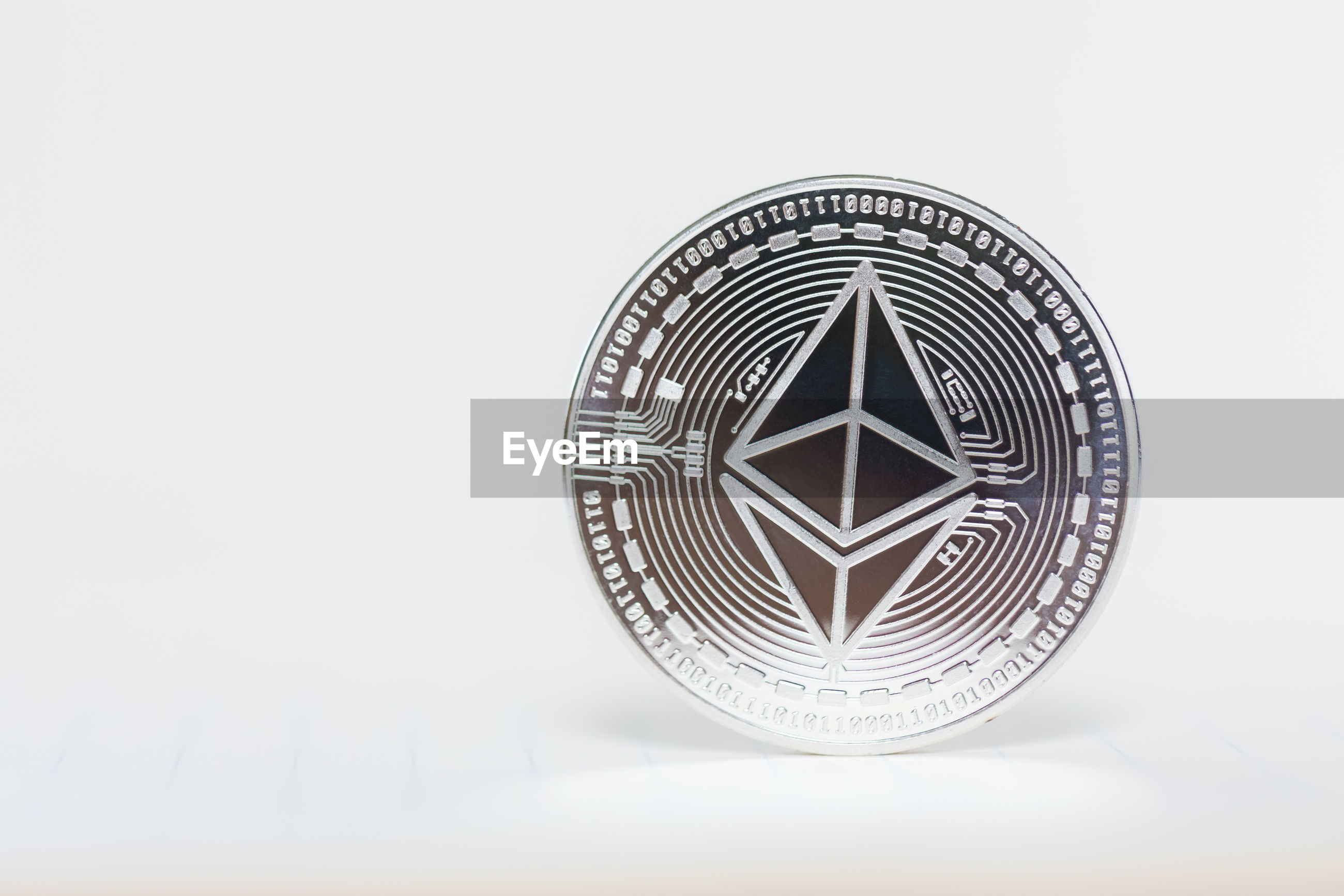 Close-up of bitcoin against white background