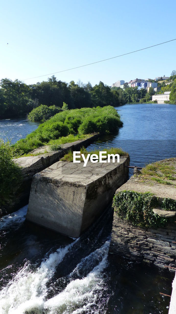 water, river, tree, nature, no people, fuel and power generation, day, hydroelectric power, motion, outdoors, growth, beauty in nature, scenics, built structure, clear sky, sky, architecture