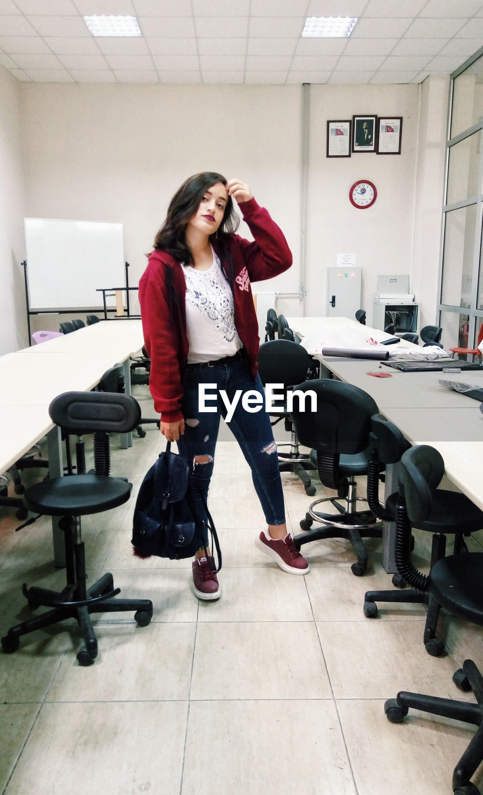 Full length of businesswoman standing in office