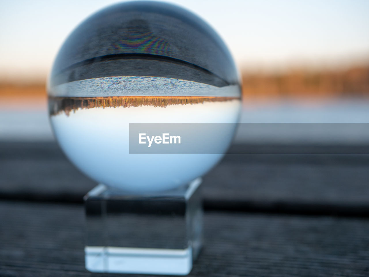 close-up, no people, drink, focus on foreground, still life, food and drink, wood - material, selective focus, table, day, water, glass - material, refreshment, sphere, outdoors, nature, reflection, transparent, food
