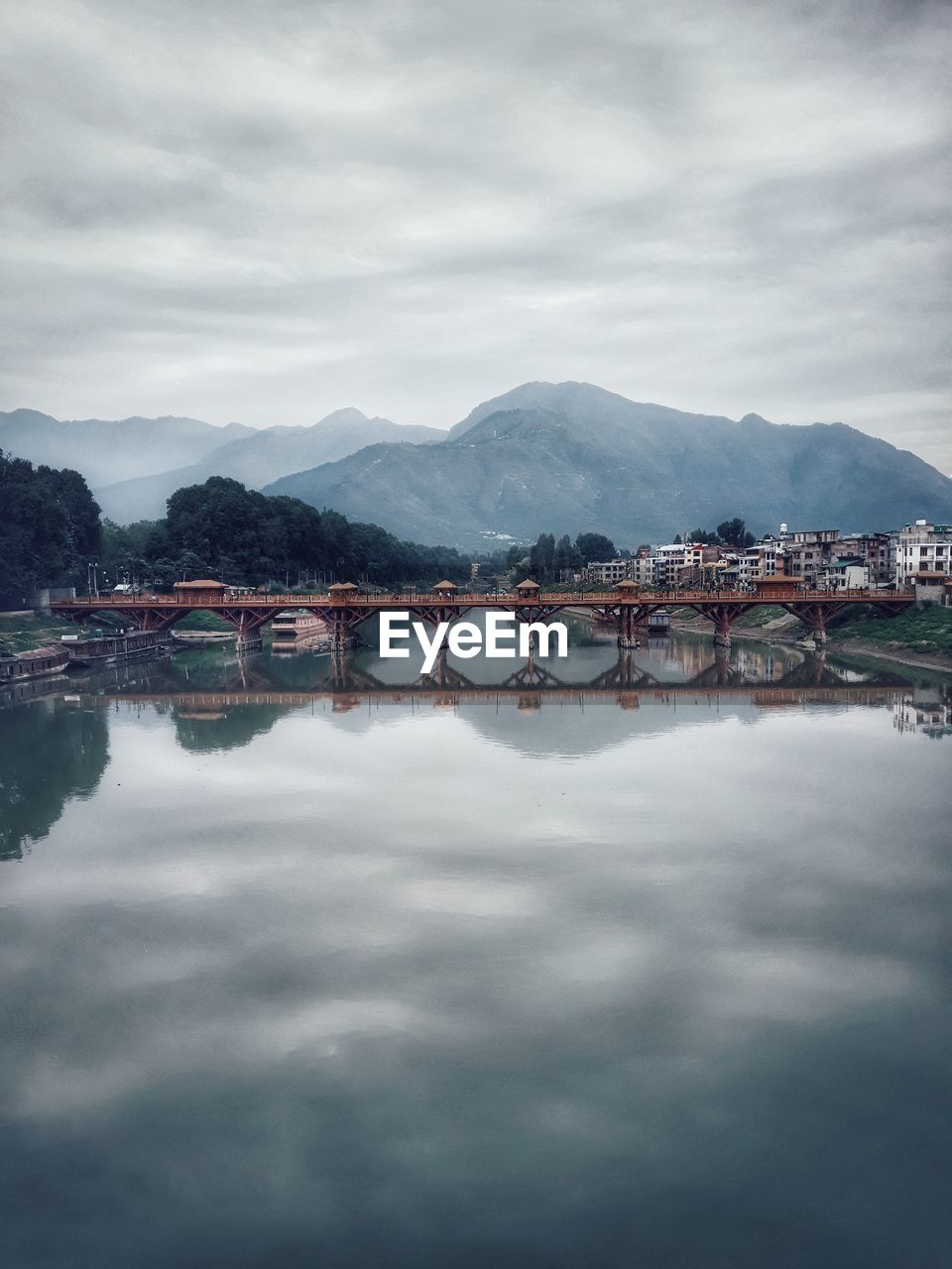 sky, water, cloud - sky, mountain, built structure, architecture, nature, bridge, waterfront, reflection, bridge - man made structure, no people, scenics - nature, connection, day, transportation, tranquility, beauty in nature, mountain range, outdoors