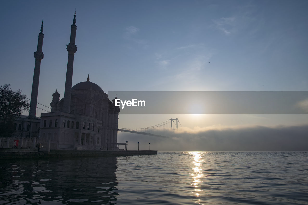 Ortakoy mosque and 15 july martyrs in foggy morning istanbul turkey