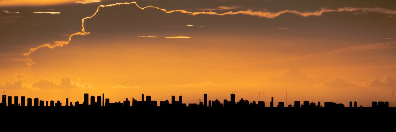 sunset, building exterior, architecture, sky, built structure, building, orange color, cloud - sky, city, silhouette, urban skyline, no people, office building exterior, cityscape, skyscraper, landscape, nature, tower, tall - high, beauty in nature, outdoors, modern, financial district