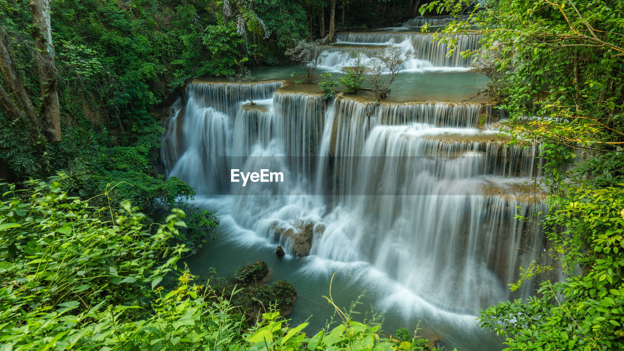 plant, forest, tree, scenics - nature, beauty in nature, waterfall, water, motion, flowing water, land, long exposure, blurred motion, rainforest, nature, environment, no people, rock, non-urban scene, green color, flowing, outdoors, power in nature, woodland, tropical rainforest, falling water