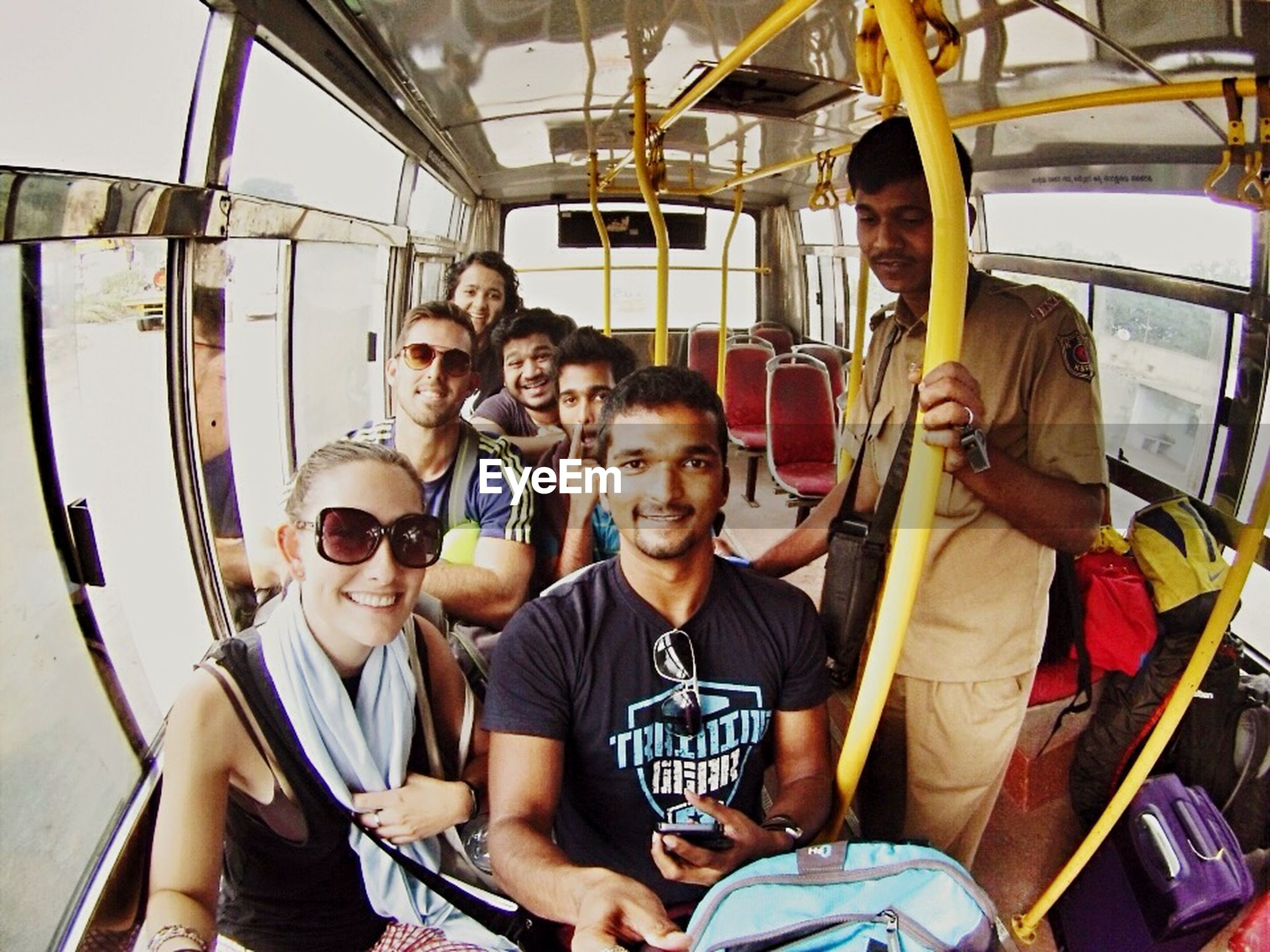lifestyles, leisure activity, togetherness, person, enjoyment, bonding, casual clothing, young men, friendship, happiness, fun, young adult, transportation, smiling, love, portrait, looking at camera, sitting