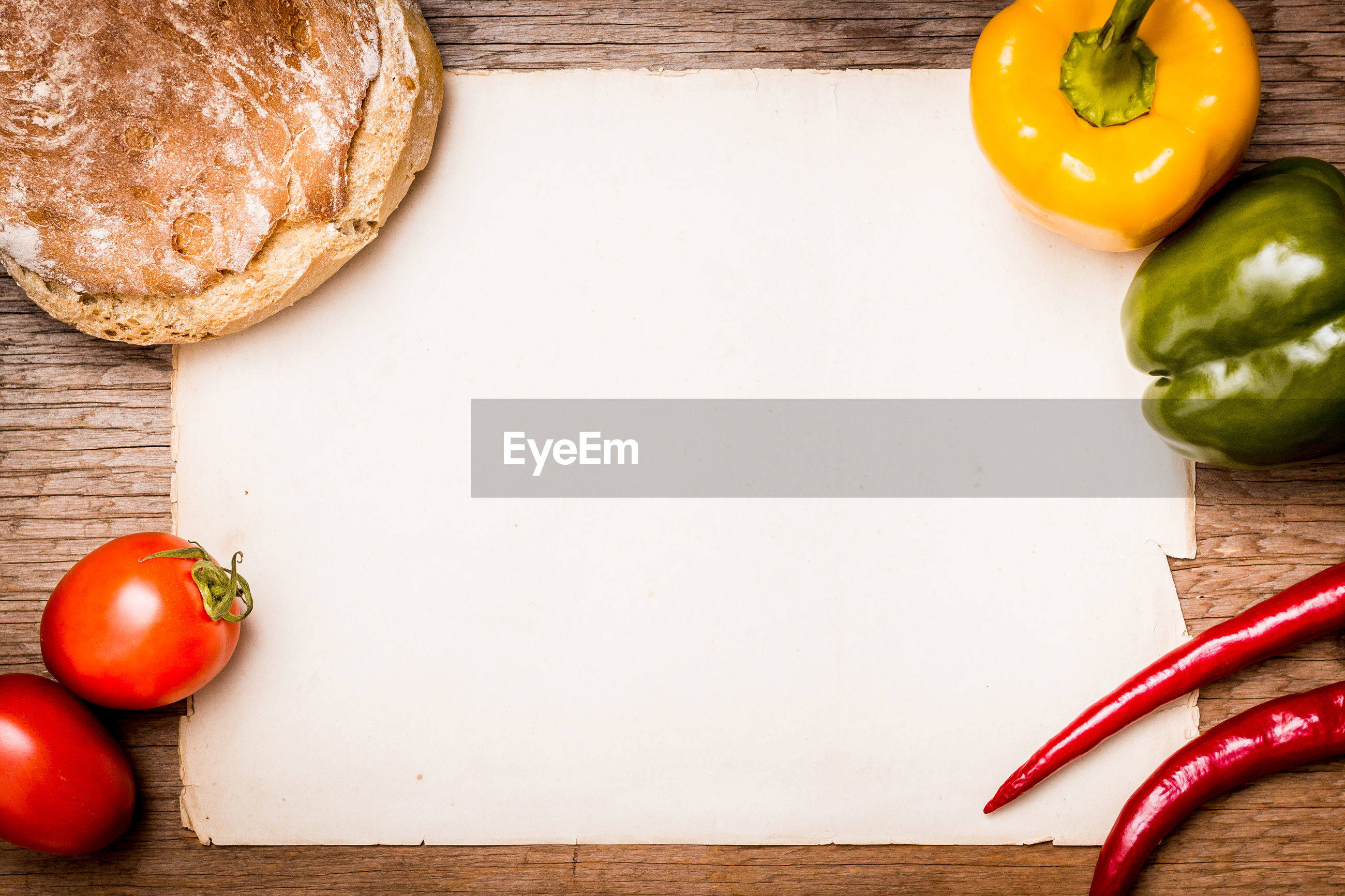 High angle view of blank paper amidst vegetables on table