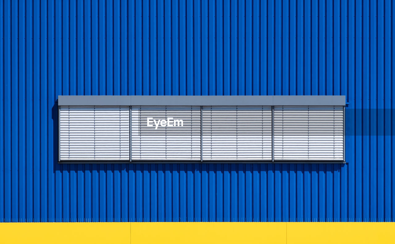 blue, pattern, backgrounds, architecture, corrugated iron, wall - building feature, no people, iron, metal, shutter, corrugated, built structure, industry, closed, business, technology, full frame, communication, garage, striped