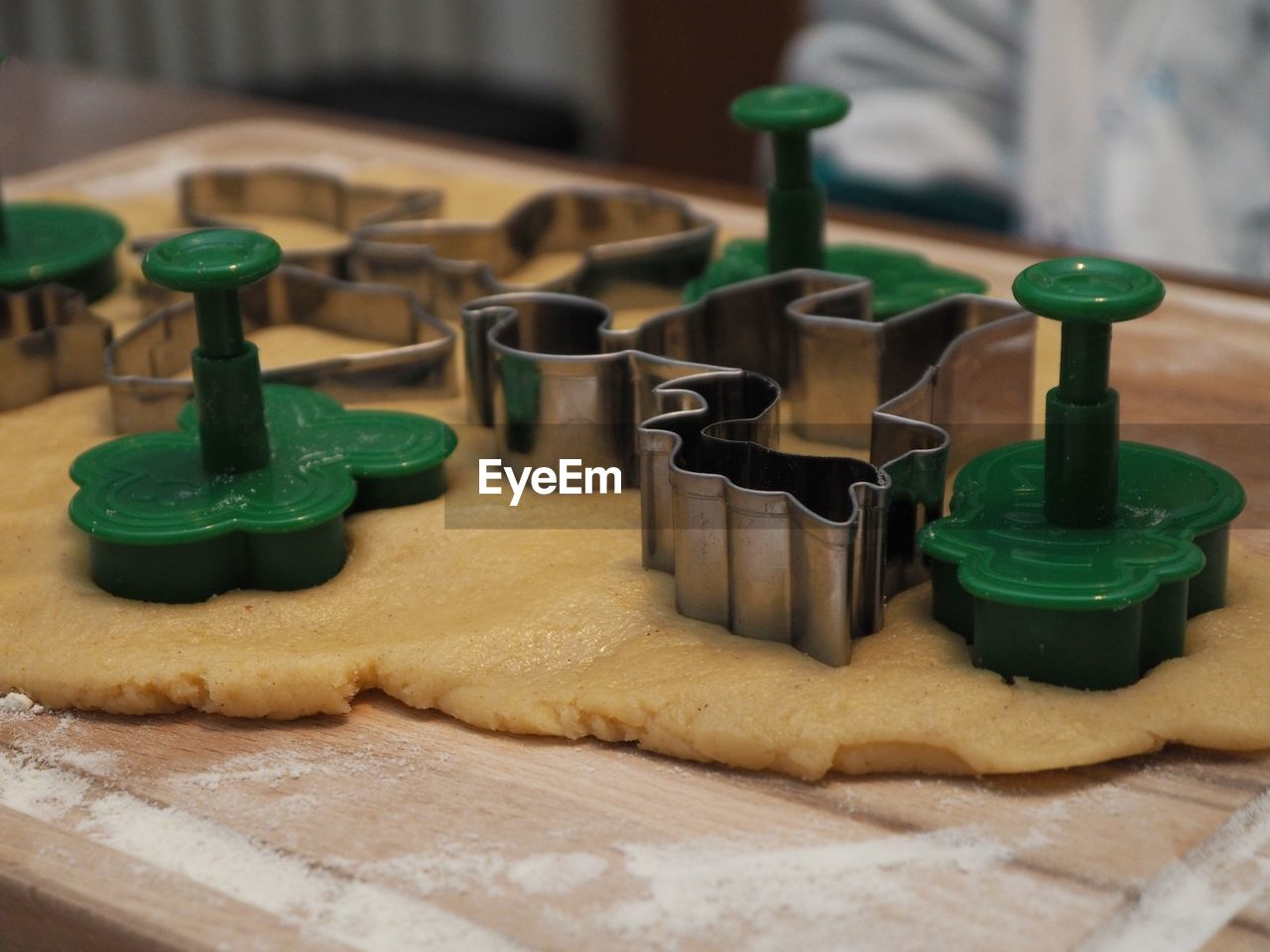 indoors, green color, close-up, still life, no people, food and drink, selective focus, table, food, focus on foreground, sweet food, baked, sweet, dessert, machinery, in a row, wood - material, equipment, preparation, plastic, tray, temptation