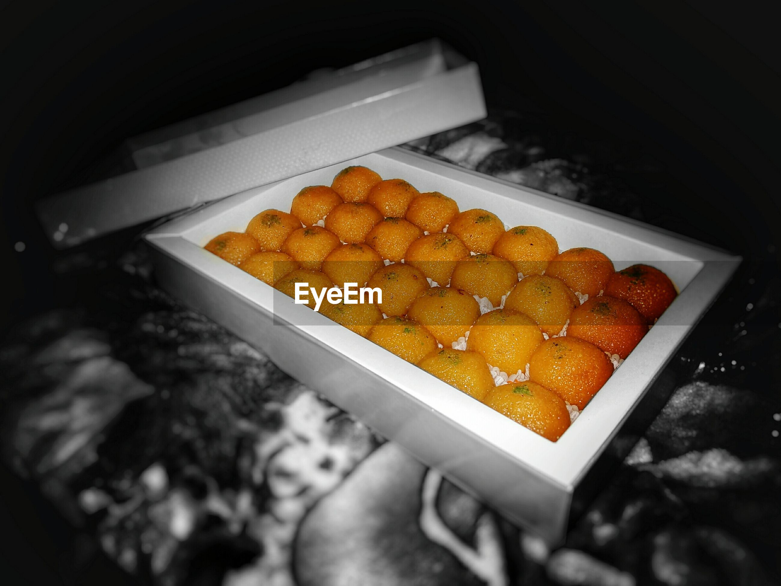 High angle view of motichur ladoos in box
