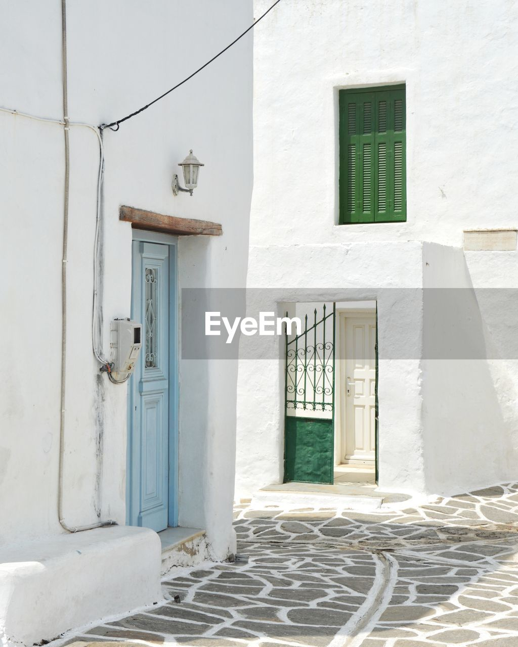 architecture, built structure, building, building exterior, door, entrance, no people, day, house, window, residential district, white color, closed, wall - building feature, outdoors, sunlight, white, security, safety, protection