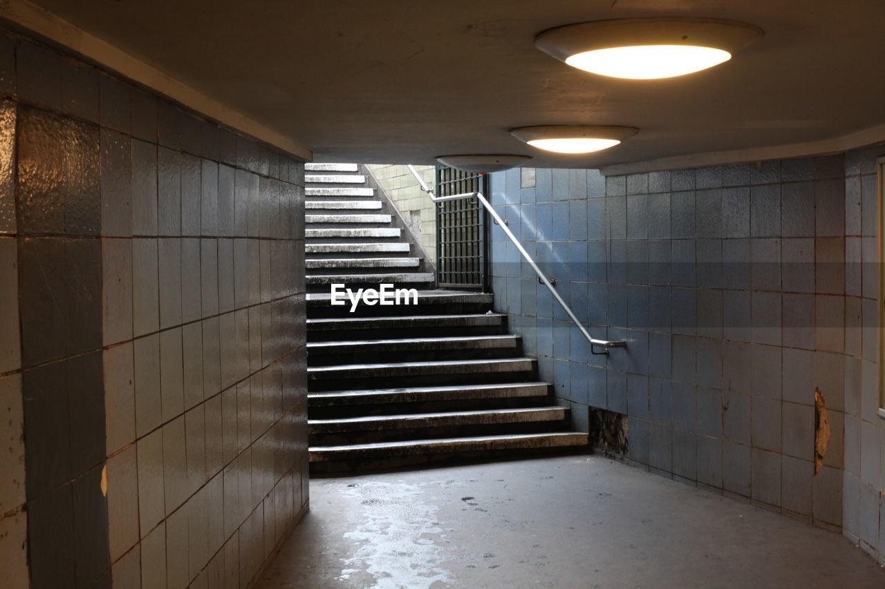 Empty stairs at illuminated subway station