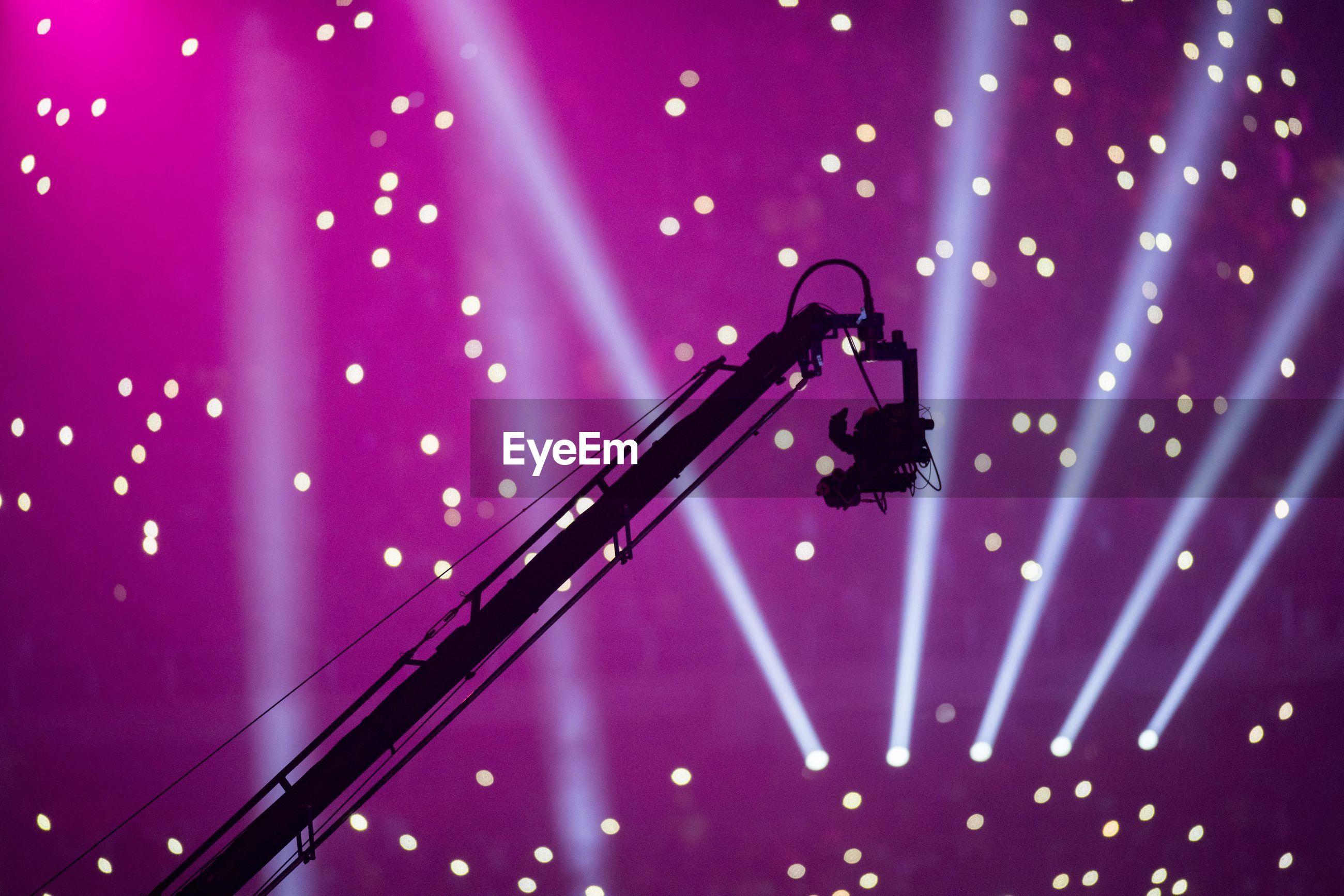 Low angle view of silhouette camera during concert